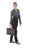 Trendy businesswoman with briefcase Royalty Free Stock Images