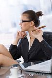 Trendy businesswoman with cigar Stock Photos