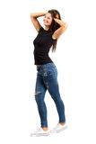 Trendy casual long hair beauty posing with fingers running through hair Stock Photo