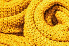 Trendy Ceylon yellow color woolen knitted fabric close-up, texture, background.  royalty free stock image