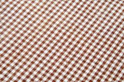 Trendy checkered gingham textile. Of brown color Stock Images