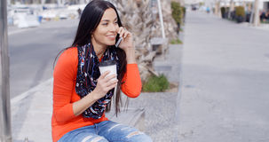 Trendy chic young woman listening to a mobile call Stock Image
