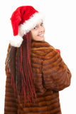 Trendy christmas girl with plait braids in fur coa Stock Photography