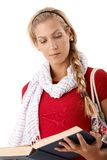 Trendy college girl reading book Royalty Free Stock Image