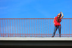 Trendy cool teenage girl on the urban bridge Stock Photos