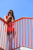 Trendy cool teenage girl on the urban bridge Stock Images