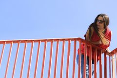 Trendy cool teenage girl on the urban bridge Royalty Free Stock Photos