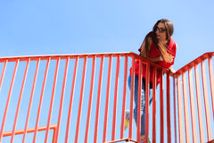 Trendy cool teenage girl on the urban bridge Royalty Free Stock Image