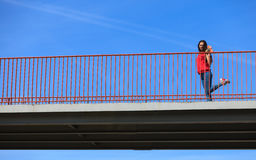 Trendy cool teenage girl on the urban bridge Stock Image