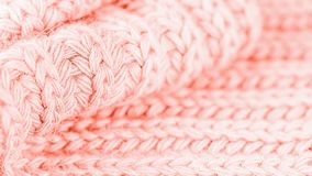 Trendy coral color. Woolen knitted pattern. Delicate and bright. 16:9. Trendy coral color. Woolen knitted pattern. Knitted background 16: 9 stock images