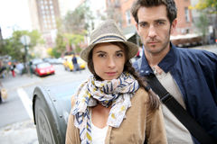 Trendy couple going shopping in new york. Couple in town standing in shopping street Stock Photo