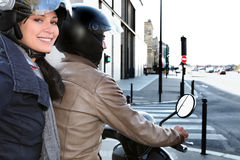 Trendy couple on a moped. Urban couple on a moped together Royalty Free Stock Images