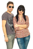 Trendy couple with sunglasses. Trendy young couple of models wearing sunglasses isolated on white background Royalty Free Stock Photos