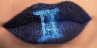 Trendy Creative lip makeup. Closeup Shiny glossy lips Gemini. Trendy Creative lip makeup. Closeup Shiny glossy lips with Gemini Zodiac Sign. Women Horoscope royalty free stock image