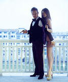 Trendy csexy couple posing on balkony in stylish suits Stock Photo