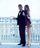 Trendy csexy couple posing on balkony in stylish suits Stock Photo