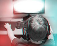 Trendy 3d Anaglyph Effect: Teenager Playing A Computer Game At Home Wearing A Headset.  stock image