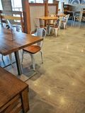 Trendy empty restaurant interior. Clean uncluttered food service dining area in neutral tones stock photos