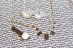 Trendy fashion accessorie set of kaleidoscopic glasses, wrist wa Royalty Free Stock Photography