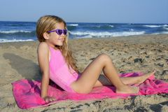 Trendy fashion little summer girl on beach royalty free stock image