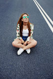 Trendy fashion model posing with skate board wearing colorful sunglasses Royalty Free Stock Images