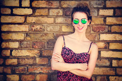 Trendy Fashion Woman at the Brick Wall. Portrait of Trendy Fashion Woman on Brick Wall Background. Girl in Summer Dress. Urban Street Style Concept. Toned Photo Royalty Free Stock Photos