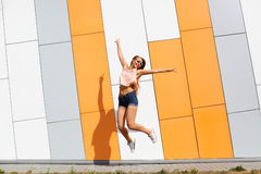 Trendy fashionable girl emotionally jumping Royalty Free Stock Photo