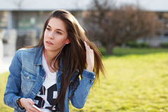 Trendy fashionable girl listening music Royalty Free Stock Photography