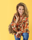 Trendy fashionable woman smiling. Beautiful trendy woman,  on yellow background Stock Images