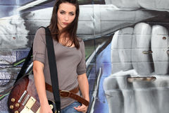 Trendy female guitarist Stock Image