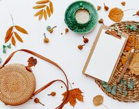 Trendy flat lay composition with coffee cup and autumn leaf