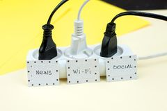 Trendy flat lay minimal concept, unplugged cord with word work, media, wi-fi.  Stock Photos