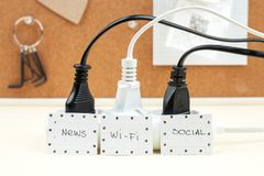 Trendy flat lay minimal concept, unplugged cord with word work, media, wi-fi.  Royalty Free Stock Image