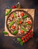 Trendy food Italian black pizza stock photo