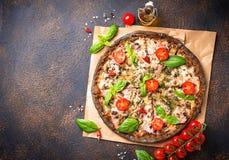 Trendy food Italian black pizza royalty free stock photos
