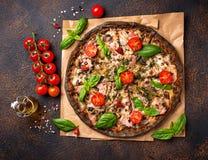 Trendy food Italian black pizza royalty free stock photography
