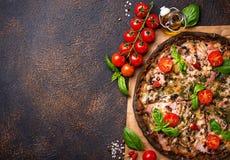 Trendy food Italian black pizza stock photos