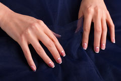 Trendy french manicure with blue tulle. Salon of nail aesthetics royalty free stock photos