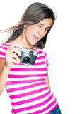 Trendy and funny young girl holding a compact camera Royalty Free Stock Photo