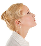 Trendy girl. Profile of positive careless girl on white Royalty Free Stock Image