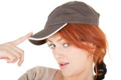 Trendy girl with baseball cap. Portrait of positive careless girl on white, focus on the eye Royalty Free Stock Images