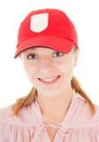 Trendy girl with baseball cap. Portrait of positive careless girl on white Royalty Free Stock Image