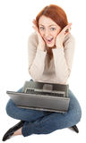 Trendy girl with computer. Portrait of positive careless girl with computer on white Stock Images