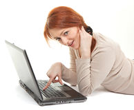 Trendy girl with computer Stock Photography