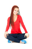 Trendy girl in ethnic hairstyle sitting, smiling Stock Photos