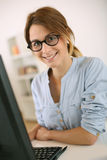 Trendy girl with eyeglasses in office Stock Images