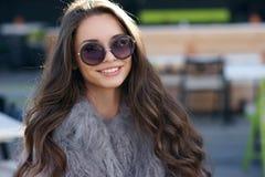 Trendy girl in fur coat Stock Photos