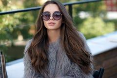 Trendy girl in fur coat Stock Images