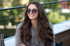 Trendy girl in fur coat Royalty Free Stock Photos