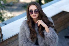 Trendy girl in fur coat Royalty Free Stock Image